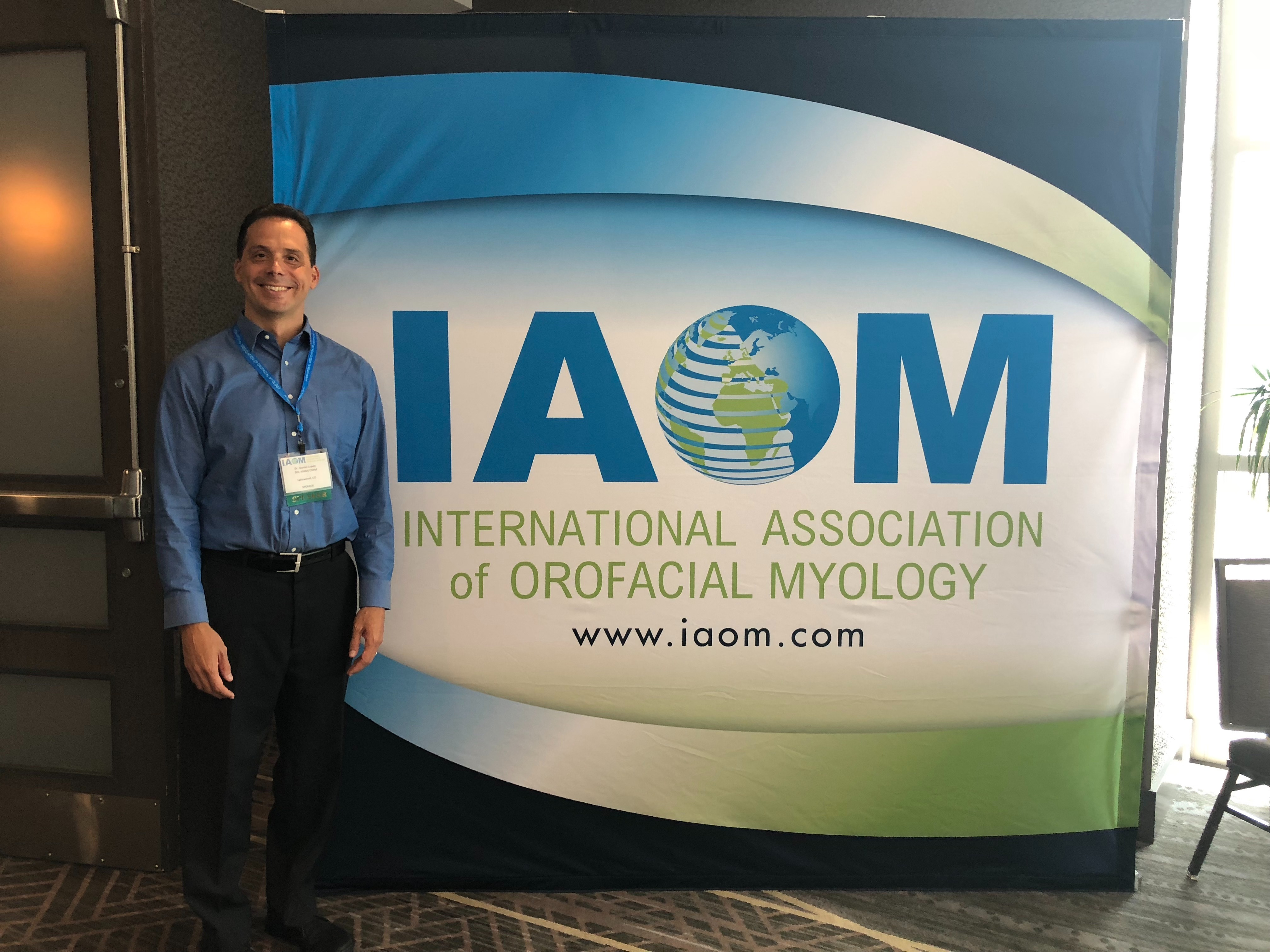 Daniel Lopez, D.O. before speaking at the IAOM in 2018