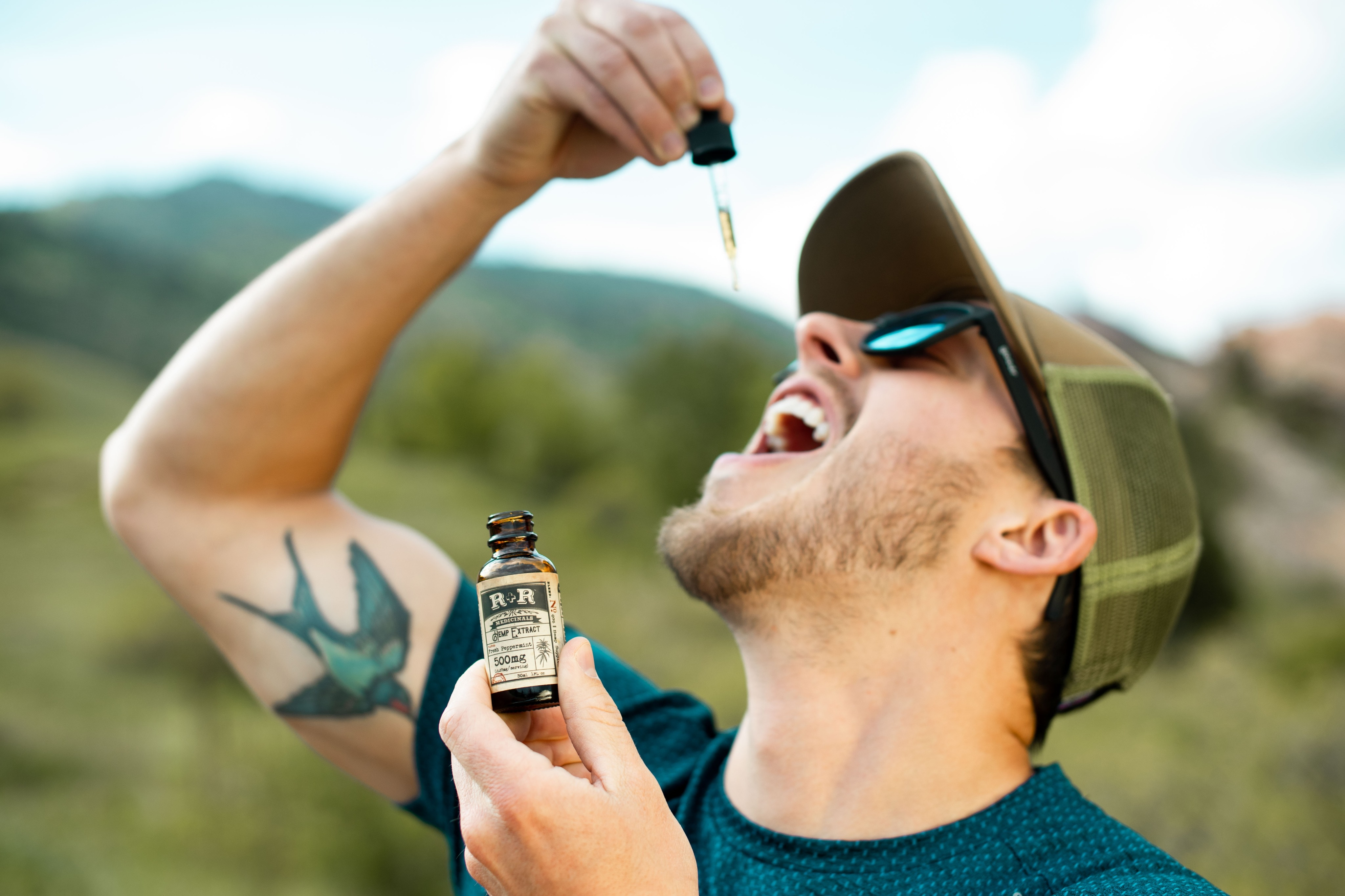 man taking hemp oil