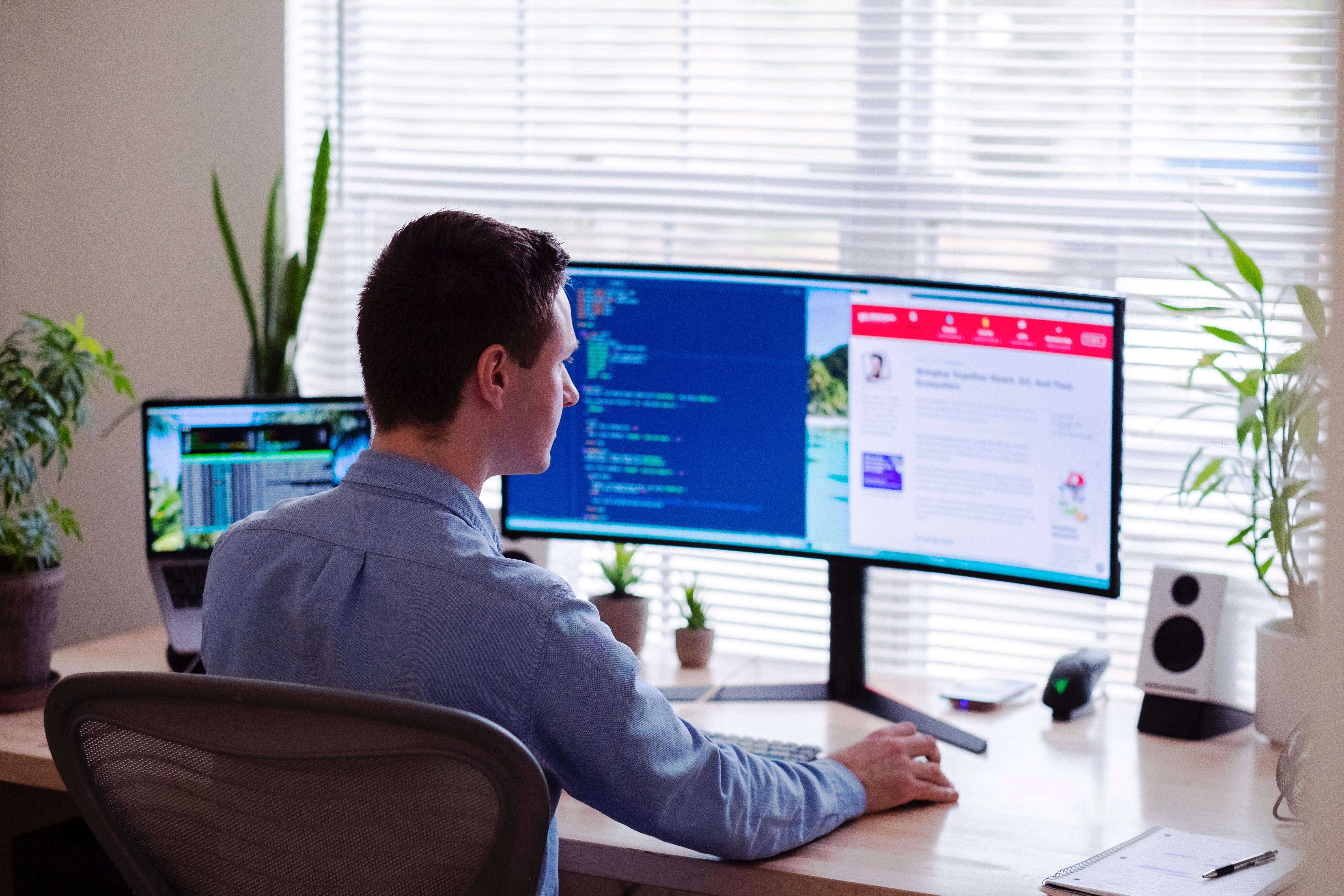 Man working in front of monitors