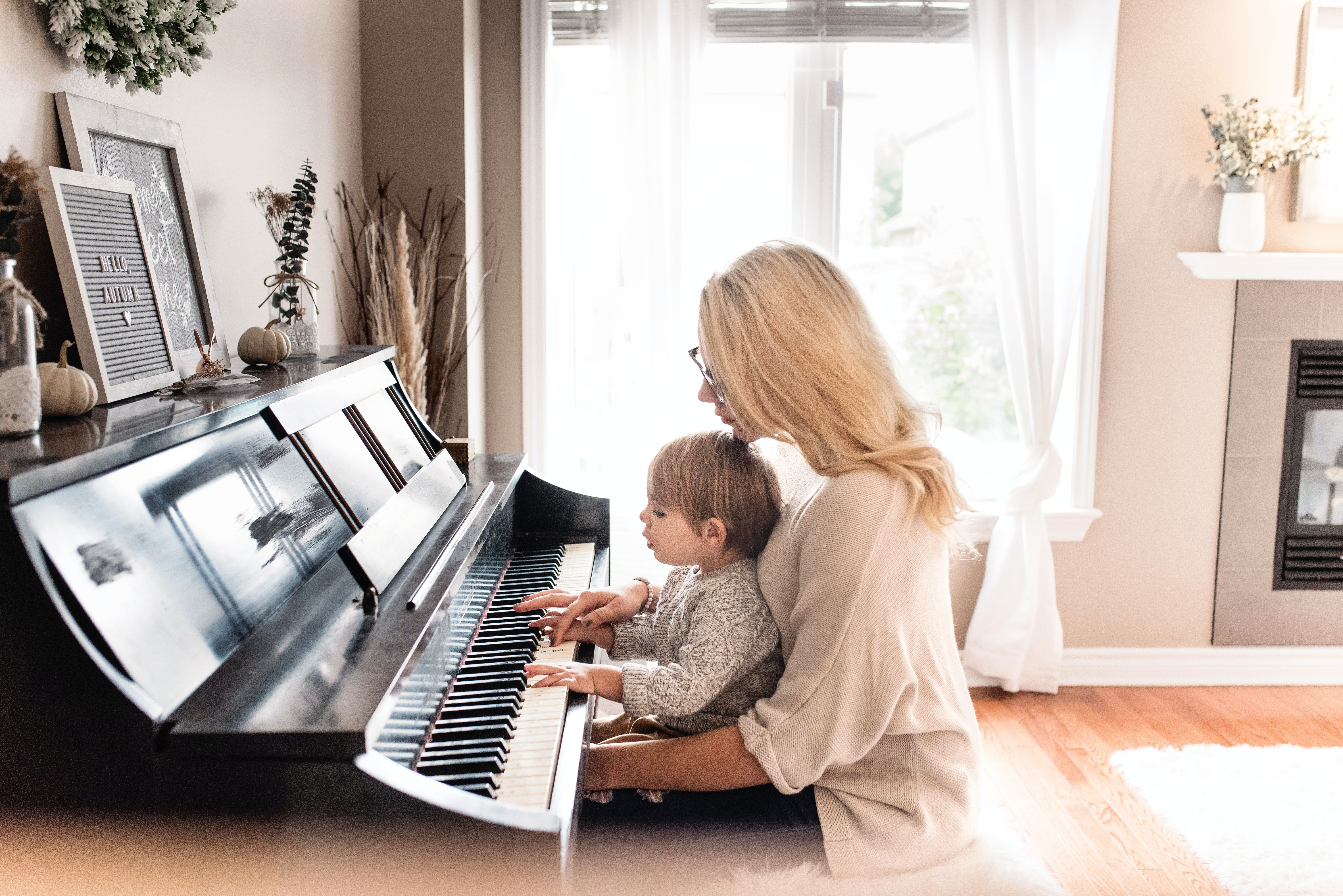 child learning to play piano