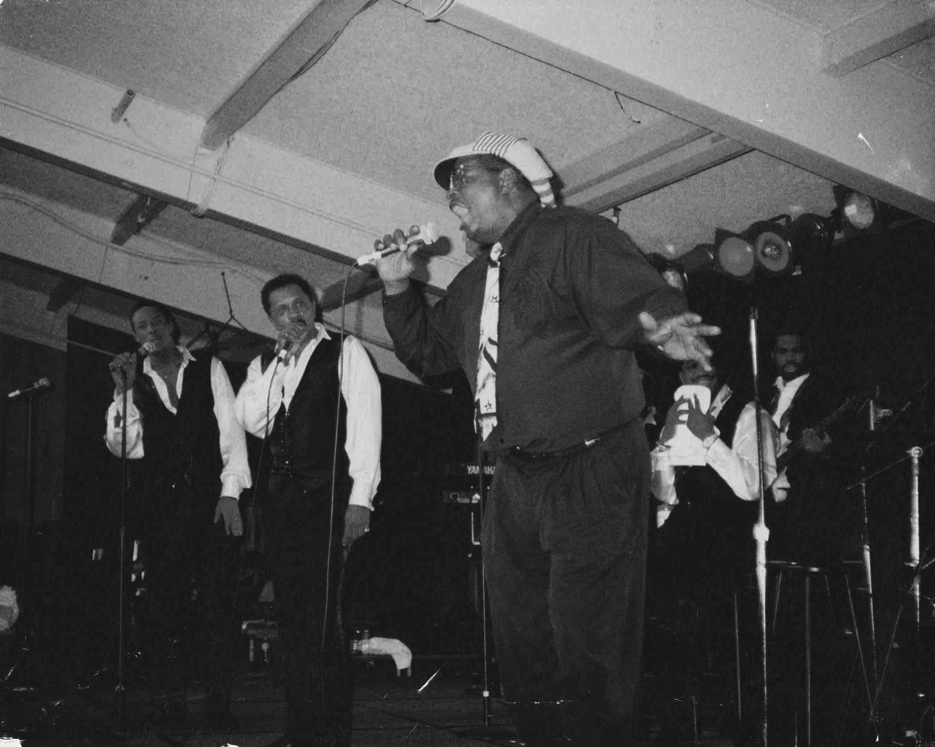 Jerry B. Bowden performing on stage with the Temptations