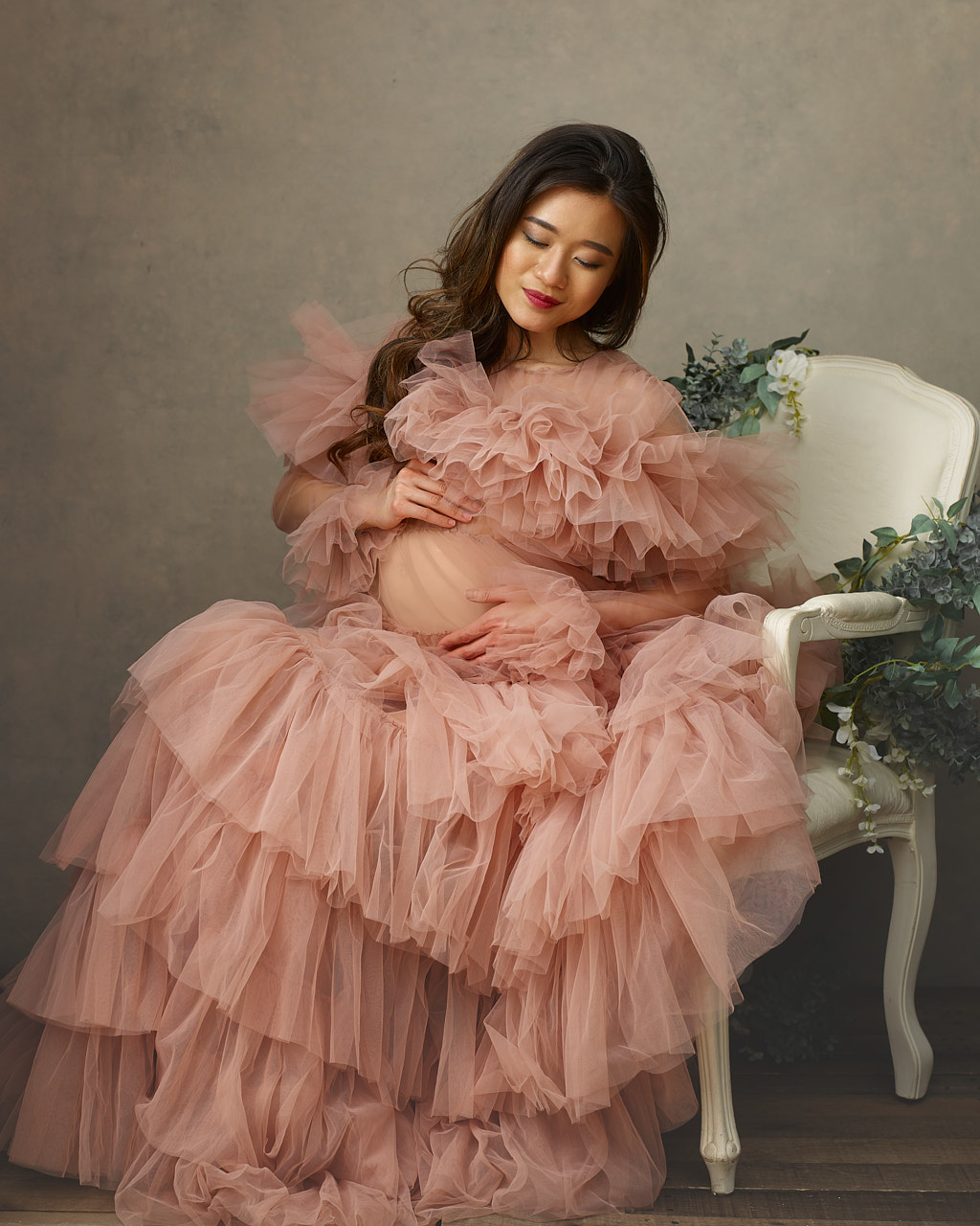 Pregnant asian woman in pink maternity gown. Maternity portrait photographer near Washington DC  Portraits by Jared Wolfe in Alexandria VA