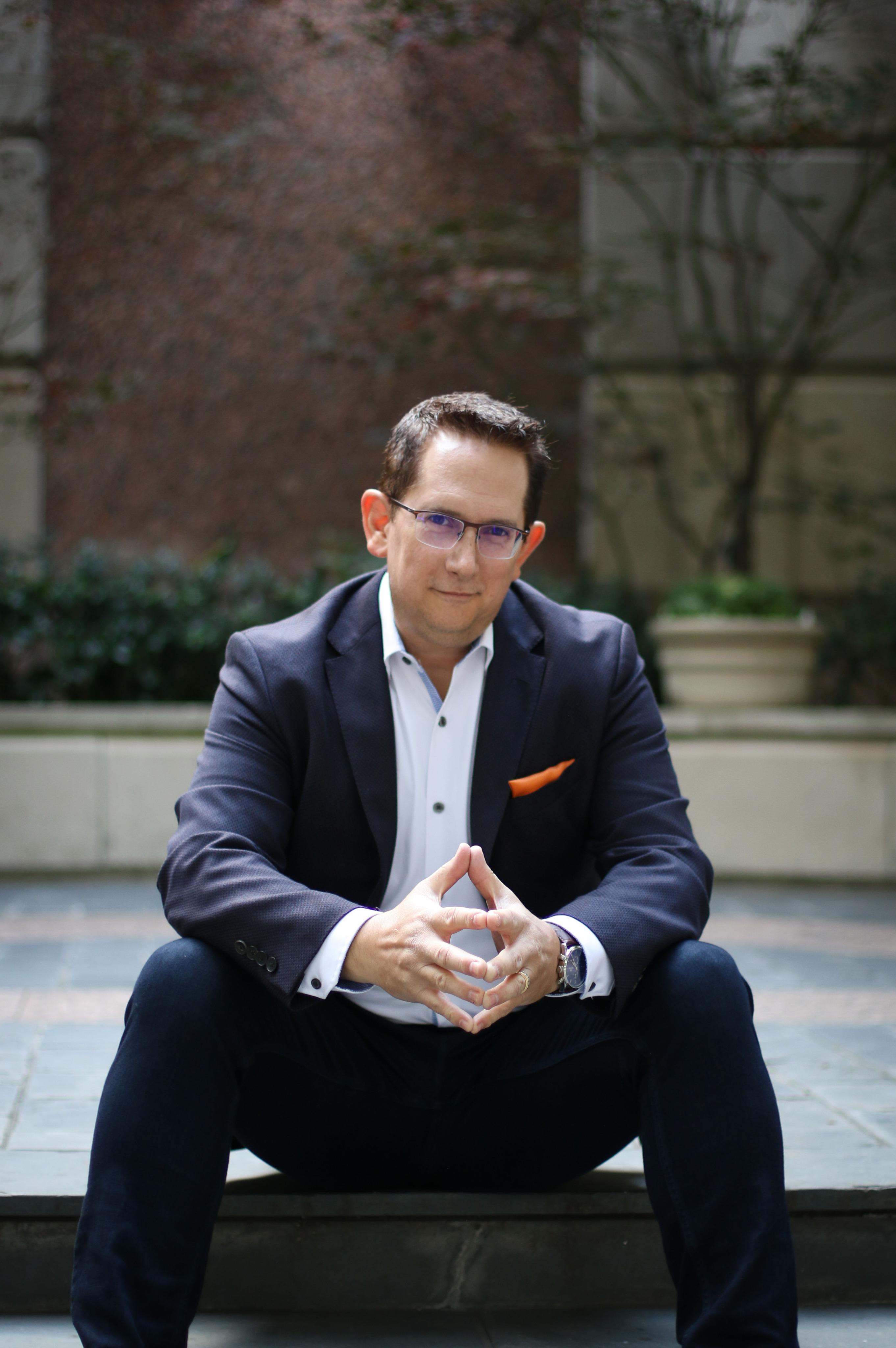Joe Paranteau, author of Billion Dollar Sales Secrets sitting with his hands tented.