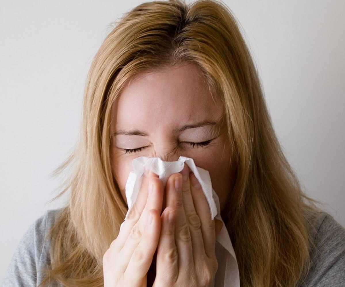 woman sneezing, keto flu symptoms