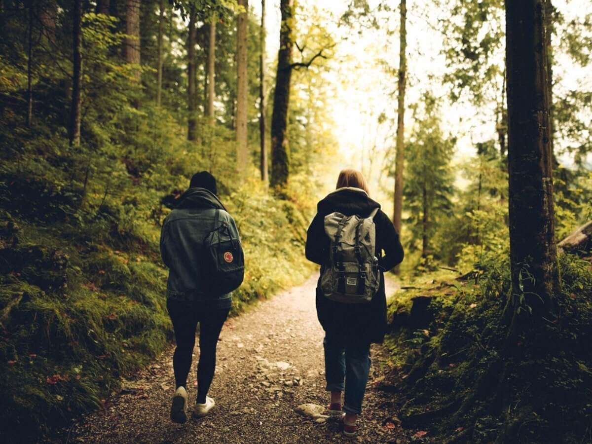 two people walking in nature, light exercise keto flu cure